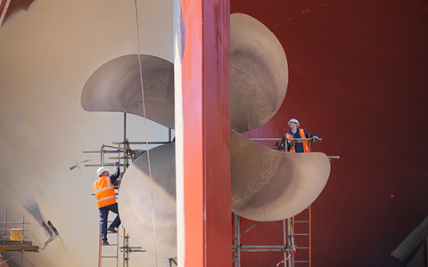 Engineers maintaining ship propellers
