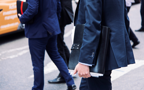 men wearing suits carrying files