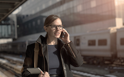 woman talking on phone to take steps to safeguard business from terrorism risk